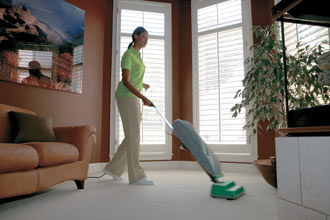 Merry Maids house cleaner vacuuming